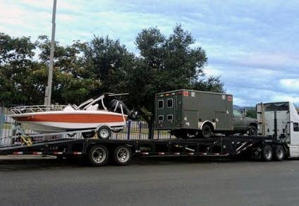 Boat & Trailer Transporting On Car Carrier
