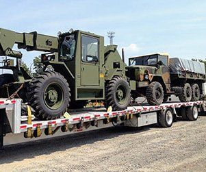 oversize military vehicles on transport trailer