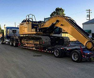 heavy construction equipment on hauler trailer