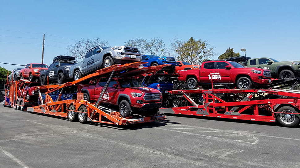Multiple Vehicles Loaded On Auto Carrier From Dealership
