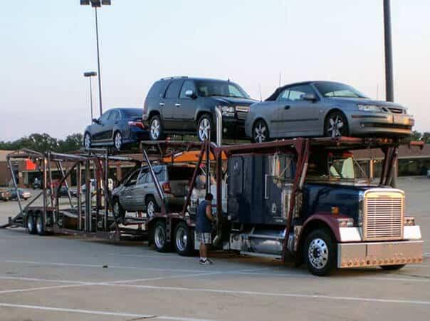 unloading car carrier shopping center