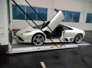 white ferrari on enclosed auto carrier lift gate