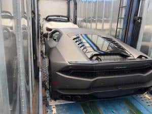 silver lamborghini shipping inside enclosed carrier