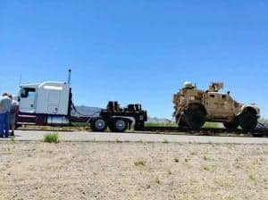 military vehicle on transport trailer